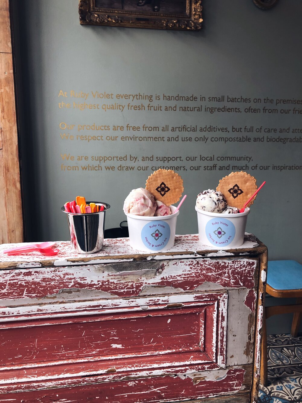Two tubs of ice creams with wafer and a pot of spoons inside the Tufnell Park parlour