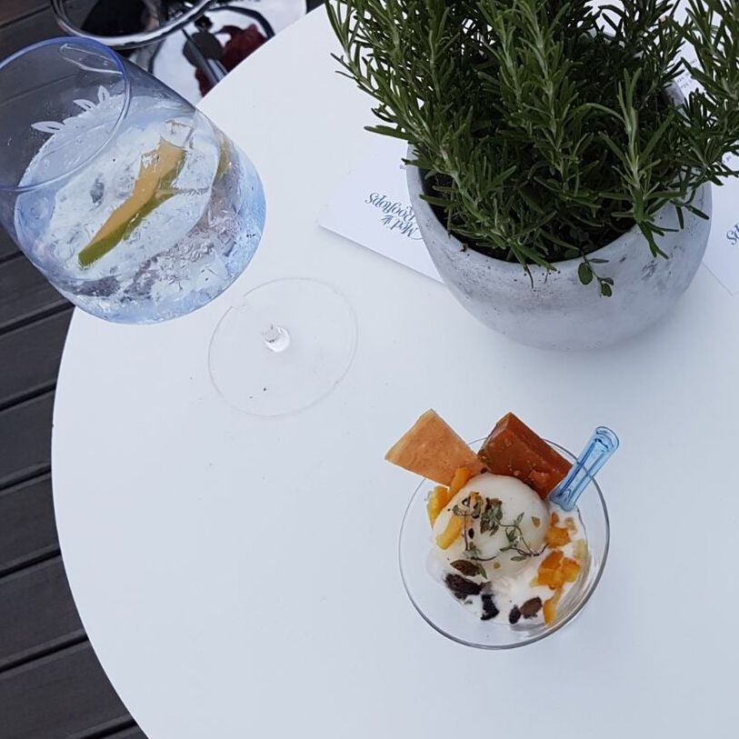 A table with a Gin Mare gin and tonic, rosemary and bespoke Ruby Violet ice cream