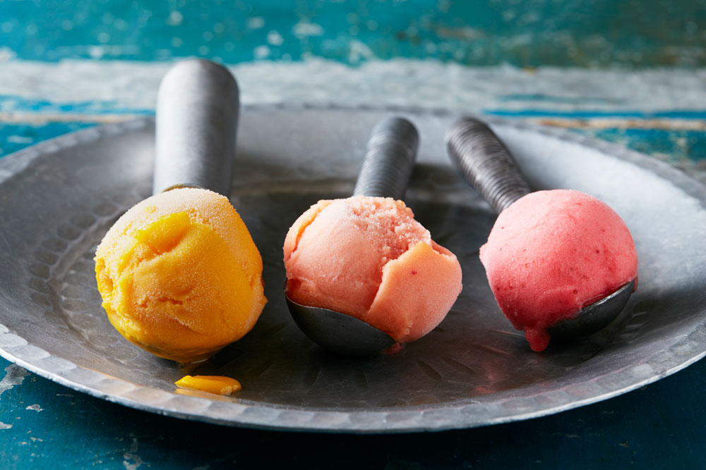 Three scoops of colourful ice cream